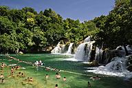 Croatia, Krka National Park, Skradinski buk, tourists bathing in pool at waterfall - BTF000371