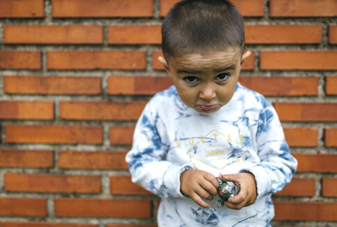 Portrait of little boy pouting mouth - MGOF000528