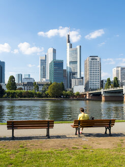 Germany, Hesse, Frankfurt, bank of River Main with financial district in background - AM004157