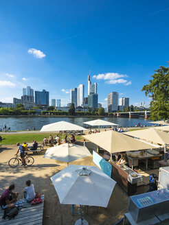 Germany, Hesse, Frankfurt, people at outdoor cafe with financial district in background - AM004159