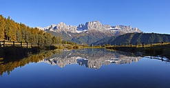 Italy, Bozen Province, Dolomites, Rosengarten group reflected in a small lake - RUEF001626