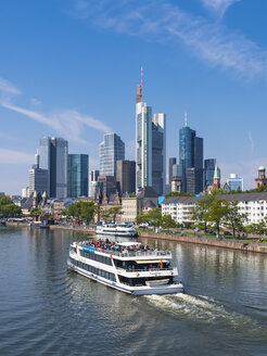 Germany, Hesse, Frankfurt, Excursion boat on Main river, financial district in the background - AM004164