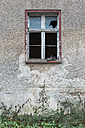 Germany, Brandenburg, facade and window of ramshackle residential house - ASCF000342