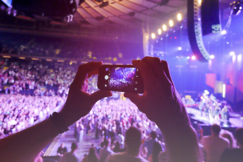Hands holding smart phone, filming concert - ON000916