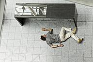 Dead man lying on tiled floor - KLR000098