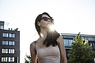 Dark-haired woman wearing sun glasses - FMKYF000629