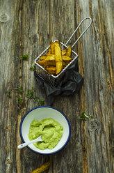 Homemade potato wedges and bowl of avocado dip - ODF001230