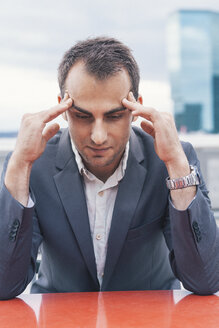 Frustrated businessman looking down - BZF000223