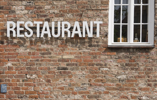 Facade of brick house with the word restaurant - VIF000372