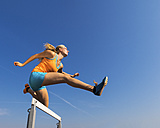 Athlete crossing a hurdle - STSF000859