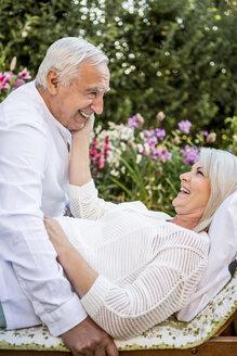 Happy elderly couple in garden - RKNF000214