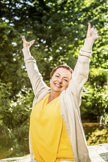 Portrait of happy mature woman in garden - RKNF000259