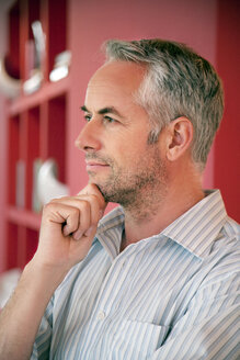 Pensive man with grey hair and stubble - TOYF001258
