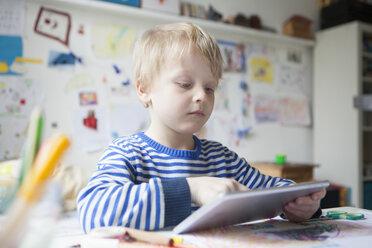 Portrait of blond little boy using digital tablet - RBF002993