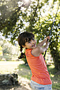 Portrait of smiling little girl in the garden - MGOF000580