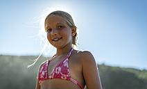 Portrait of a blond little girl wearing bikini top - MGOF000589