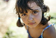 Portrait of serious looking little girl on the beach - MGOF000594