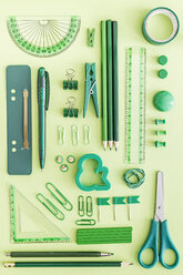 Green office supplies on green background - MELF000069