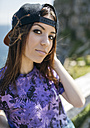Portrait of young woman with baseball cap - MGOF000622