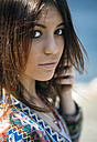 Portrait of young woman with brown hair and brown eyes - MGOF000625