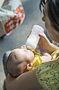 Mother bottle-feeding baby - DEGF000517