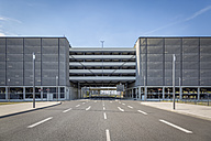 Germany, Berlin Brandenburg Airport, car park and empty road - NKF000401
