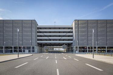 Germany, Berlin Brandenburg Airport, car park and empty road - NKF000401