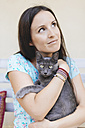 Woman holding Russian Blue - GEMF000342