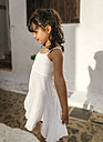 Spain, Balearic Islands, Menorca, Binibeca, portrait of little girl standing at sunlight - MGOF000648