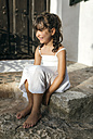 Spain, Balearic Islands, Menorca, Binibeca, portrait of little girl sitting on a step - MGOF000653