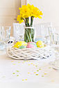 Laid Easter table with bunch of daffodils - LVF003775