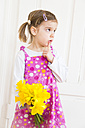 Portrait of little girl with bunch of daffodils - LVF003780