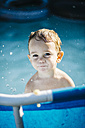 Portrait of little boy in a paddling pool - JRFF000047