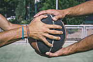 Men holding basketball - ABZF000113