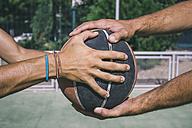 Men holding basketball - ABZF000113