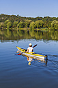 Germany, Stuttgart, woman kayaking on Max-Eyth-See - WDF003248