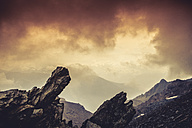 Italy, Lombardy, Alps, Rocks at sunset, textured effect - DWIF000601