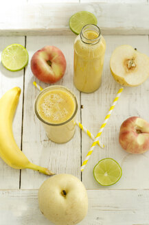 Fruits, glass bottle and glass of fruit smoothie on wood - ODF001261