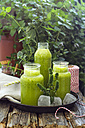 Three glasses of green smoothies with peppermint - ODF001276