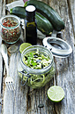 Preserving jar of sliced courgettes with lime and spices - ODF001272