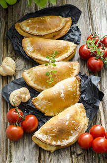 Row of five Calzone stuffed with tomatoes and sage - ODF001269
