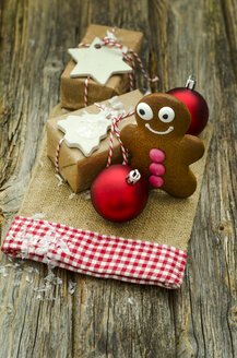 Christmas present, gingerbread man and two red Christmas baubles - ODF001283
