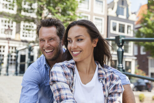 Netherlands, Amsterdam, happy couple outdoors - FMKF002155