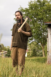 Man with axe standing in the country - MIDF000613
