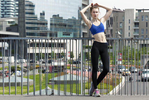 Young woman doing workout in the city - PASF000019