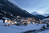 Austria, Tyrol, view on Ischgl in winter at dusk - ABF000651