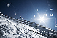 Austria, Tyrol, Ischgl, avalanche protection and cable car in winter landscape - AB000657