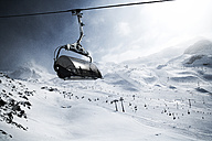 Austria, Tyrol, Ischgl, cable car in winter landscape in the mountains - ABF000645