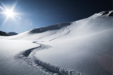 Austria, Tyrol, Ischgl, ski tracks in powder snow - ABF000640