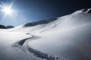 Austria, Tyrol, Ischgl, ski tracks in powder snow - ABF000640